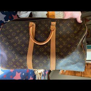 Auth Louis Vuitton keepall 45 bandolier duffel bag